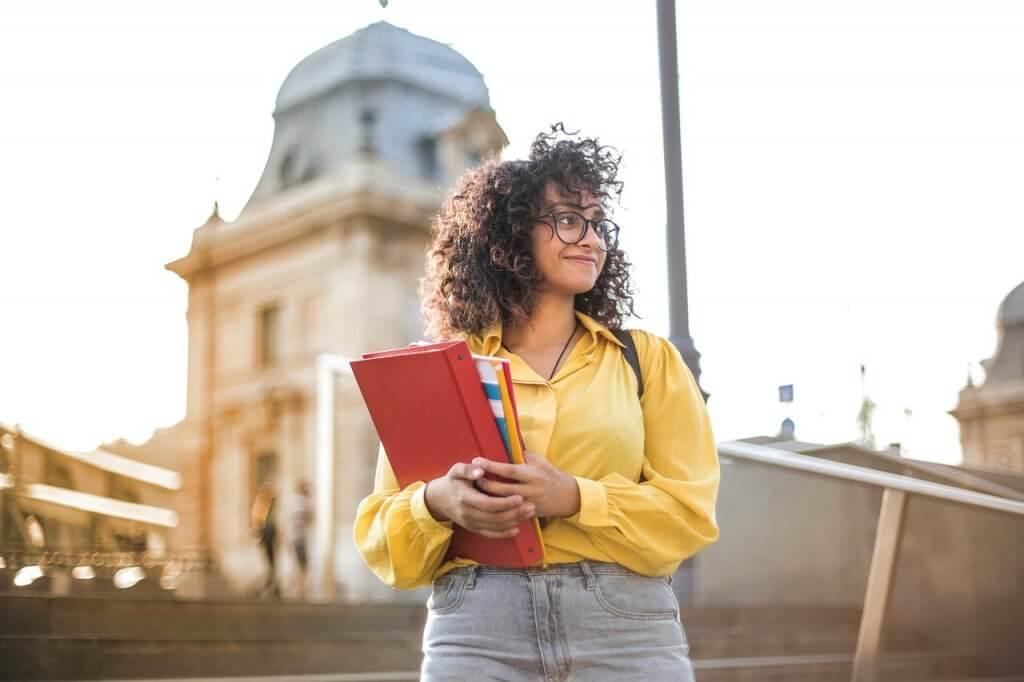 girl holding school books
